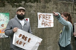 """CO-CONSPIRATORS! :  Neal Breton (the one with the puzzled look on his face) will run an """"art truck"""" and New Times editor Ashley Schwellenbach (hiding behind her own arm) will orchestrate the shenanigans of the entire Box City event on Feb. 25. - PHOTO BY GLEN STARKEY"""