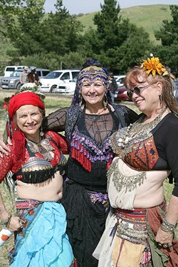 THREE QUEENS :  A trio of belly dancers struck a pose before performing for the crowd. - PHOTO BY GLEN STARKEY