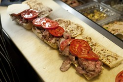 JUICY :  Thick slabs of bright red, fresh tomatoes top luscious slices of roast beef.