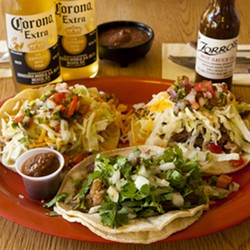 TRY 'EM :  The delicious tacos at Zorro's satisfy during happy hour. At $2 each, they pair well with a cold Corona and fresh chips and salsa. - PHOTO BY STEVE E. MILLER