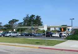 A SHINING EXAMPLE :  A project three years in the making would supply nine Coastal Unified campuses with up to 50 percent of their electric needs using solar carports like the one proposed for Baywood Elementary in Los Osos (artist rendering shown). - PHOTO ILLUSTRATION COURTESY OF FIRMA CONSULTANTS, INC.