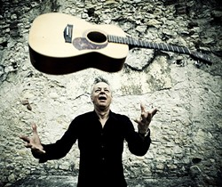 MAGIC FINGERS:  Amazing finger style guitarist Tommy Emmanuel returns to the PAC for an evening of acoustic magic on Jan. 21. - PHOTO BY SIMONE CECCHETTI