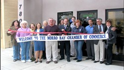 WELCOME TO THE NEIGHBORHOOD :  Lynch (pictured cutting ribbon, center) was a member of the Morro Bay Chamber of Commerce, where he operated the medical marijuana dispensary for just under a year, until it was raided in March 2007. - PHOTO COURTESY OF RICK RAY FILMS