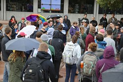 """STAND IN SOLIDARITY:  Cal Poly students congregated at University Union plaza on Nov. 15 to rally against offensive comments written on a """"free speech wall."""" Students discussed the lack of diversity at Cal Poly and their experiences with discrimination and belonging on campus. - PHOTO BY DYLAN HONEA-BAUMANN"""