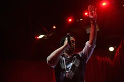 """EMCEE!:  Brotha """"C"""" kept the night moving along by performing karaoke in between rounds. - PHOTO BY ANNA STARKEY"""