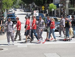 STRUTTING THEIR STUFF :  There were 150 registered walkers at this year's Walk a Mile in Her Shoes event. Proceeds were split between the SARP Center and the SLO Symphony. - PHOTO COURTESY OF MEGAN MASTACHE