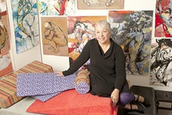 IN LIVING COLOR :  Artist Joanne Ruggles, pictured, often renders the human form in brilliant colors, though her latest body of work is dominated by shades of black, white, and grey. - PHOTO BY STEVE E. MILLER