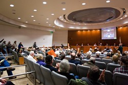 CONTENTIOUS DIVIDE:  Santa Margarita area residents filled the County Board of Supervisors' Chambers on Dec. 11 to give the planning commission their take on a proposed quarry on Highway 58, three miles east of town. - PHOTO BY KAORI FUNAHASHI