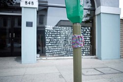 KNIT TAG :  Even a humdrum parking meter looks a little cozier with knitted apparel. - PHOTO BY STEVE E. MILLER