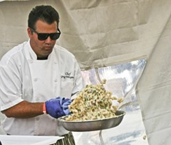 MAN OF THE MAC:  Gardens of Avila Executive Chef Gregg Wangard proudly snagged the First Place People's Choice Award at the third annual Mac and Cheese Festival, held at the Avila Beach Golf Resort on Aug. 23. - PHOTO BY REID CAIN