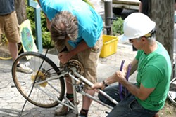 TAG TEAM:  Tall Bike Posse members Tom Smith and Bill Mulder make quick work of a bike frame during the Bike Build on April 18. - PHOTO BY GLEN STARKEY