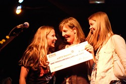 ALL SMILES :  (Left to right) Downtown Brew's Korie Newman, Arts Obispo's Programs Manager Alissa Maddren, and AmeriCorp volunteer coordinator at Arts Obispo Jamie Dietze hold a check for $1,000. - PHOTO BY STEVE E. MILLER