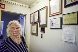 WOMAN OF THE YEAR:  With a wall covered in certificates and plaques of recognition for her work with sick children, Sjany de Groot has - received commendations from state officials, as well as late-President Ronald Reagan. - PHOTO BY COLIN RIGLEY