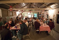 """GET OUT :  When New Times visited Sunny Acres in December 2008, residents used the """"ag barn"""" as a communal dining room. A recent injunctive order, however, will force ranch owner Dan DeVaul to vacate most of the structures previously used to house and feed residents. - FILE PHOTO BY STEVE E. MILLER"""