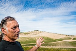 DRAWING THE LINE:  Adelaida residents like Gianni Manucci (pictured), owner of Wild Coyote Estate Winery and Bed and Breakfast, want less development and event-hosting at the wineries in the region. - FILE PHOTO BY KAORI FUNAHASHI
