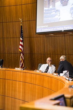 AGREE TO DISAGREE:  Bruce Gibson (right) talks to Frank Mecham (left) during a break before the Supervisors discussed the proposed Paso water district. In a deciding vote Mecham changed his position from previous votes, thereby shifting the Supervisors' position on a bill currently going through the state senate. - PHOTO BY HENRY BRUINGTON