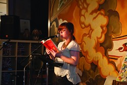 ALMOST POETRY:  New Times managing editor Ashley Schwellenbach read a passage from her debut young adult novel Scourge of the Righteous Haddock. - PHOTO BY COLIN RIGLEY