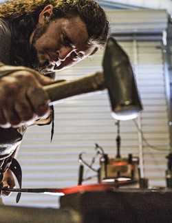 TINKER TAILOR :  Randolph hammers the scorching steel to draw it out and elongate it. - PHOTO BY KAORI FUNAHASHI