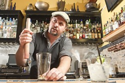 BARTENDER ROULETTE:  Novo Bar Manager Matt Hanson encourages his staff to be creative and concoct their own exclusive cocktails in what's known as the Bartender's Roulette. - PHOTO BY STEVE E. MILLER