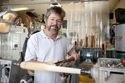 THE IMPORTANCE OF BEING RUDE :  Wood-turner Michael Rude spend time amid a vast array of sharp objects. - PHOTO BY STEVE E. MILLER