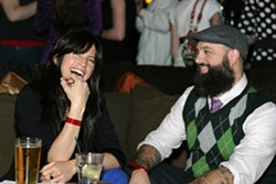 BEAUTY AND THE BEAST :  Ms. Hotness (aka—Darci Spiker) chats it up with Embodiment artist and enormously bearded San Luis Art Supply owner Neal Breton. - PHOTO BY GLEN STARKEY