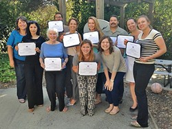CERTIFIED COUNSELORS:  Volunteers at the Women's Shelter Program of SLO County pose for a photo with their domestic violence counselor certificates. The shelter is looking for volunteers to take part in an upcoming training program that starts on Dec. 9. Volunteers are critical to the 24/7 operation of the shelter. - PHOTO COURTESY OF THE WOMEN'S SHELTER PROGRAM OF SLO COUNTY