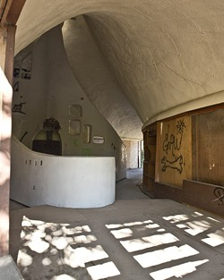 """THE SHELL OF A HOUSE:  Third-year history major Ryan Kadlec analyzes Cal Poly's """"Shell House""""—vandalized by some, treasured by others—as an example of the changing reactions to public art. - PHOTO BY STEVE E. MILLER"""