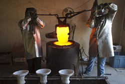 The crucible is removed from the furnace. - PHOTO BY STEVE E. MILLER