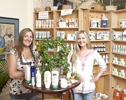 NATURAL GLOW :  Janene Lasswell (left) and beauty consultant Ashlee Newman can recommend scores of lotions, oils, and shampoos tailored for customers wary of mass-produced products. - PHOTO BY STEVE E. MILLER