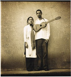 POWER COUPLE :  Quetzal Flores, founder of Quetzal, plays guitar for the musical ensemble and his wife Martha Gonzalez is the lead vocalist and percussionist for the group - PHOTO COURTESY OF QUETZAL