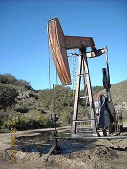 OIL ON THE GROUND:  Greka Energy's Bell Lease facility saw three spills in the days after Christmas—Dec. 26, 27, and 28—though company officials later emphasized that the separate spills were the result of a single incident. The third and final spill was blamed on a faulty packing valve at one of the company's wellheads (pictured here), which leaked 120 to 160 gallons of crude oil and an undetermined amount of produced water. All three spills happened at different locations on the Bell Lease property. The Santa Barbara County Fire Department has since issued a stop-work order for the facility. County and state officials estimated a cumulative total of more than 1,500 gallons of oil spilled over the three-day period. - PHOTO COURTESY SANTA BARBARA COUNTY FIRE DEPARTMENT HAZARDOUS MATERIALS UNIT