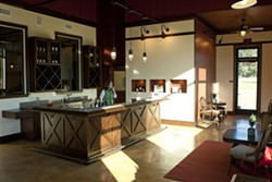 BRIGHT WINES :  The tasting room is large, bright, and inviting with interior decoration designed by Mrs. Stolo.