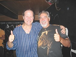 CUBA LIBRE :  Jorge Milanés of Los Osos, shown here with musician Pablo Menéndez, is planning a trip to Cuba after travel restrictions were eased last month for Cuban Americans. - FILE PHOTO