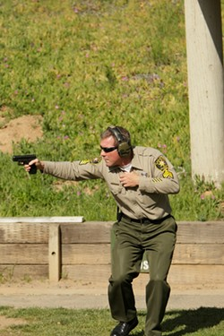 THE GOOD:  Years of intensive training allow SLO County Sheriff's Department Senior Range Master Steve Odom to fire his weapon while evading returned fire, exactly the kind of training needed by a citizen hoping to protect their home with a firearm. Most gun owners lack such training. - PHOTO BY STEVE E. MILLER