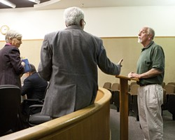 """OF OUR ELABORATE PLANS, THE END :  Peter Miller [right]—last of the so-called """"Doobie Dozen"""" is offered a congratulatory handshake from his attorney, David Fisher, as Deputy District Attorney Sandy Mitchell [left] looks on. - PHOTO BY STEVE E. MILLER"""