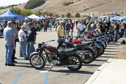 SHOW BIKES :  Vintage bike aficionados wander between a line of classic bikes and vendors' booths during the recent annual SLO Classic Motorcycle Show at Mountainbrook Community Church. - PHOTOS BY STEVE E. MILLER