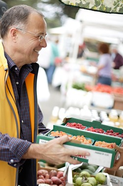 GETTING FRESH :  Charles Myers insists on nothing but the best local vegetables and fruit for his Big Sky Cafe , and is there any better place to find them than the farmers' market downtown? - PHOTO BY STEVE E. MILLER