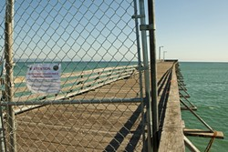 BARRICADED :  Half of the Cayucos Pier was recently closed off to the public after a Tribune reporter and photographer raised questions about its safety. - PHOTO BY STEVE E. MILLER