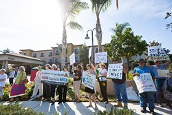 MAD ABOUT WATER:  Demonstrators showed up at a Sept. 21 DOGGR hearing to protest approval of a Freeport McMoRan application to exempt a local aquifer from the Safe Drinking Water Act. - PHOTO BY KAORI FUNAHASHI