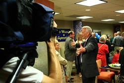 LIGHTS, CAMERA … :  Despite a losing night, Ed Waage entertained TV reporters during an interview. - PHOTO BY COLIN RIGLEY