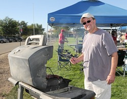 GRILL MASTERS :  Winemakers cook up their best for the Paso Robles Winemakers' Cook-Off, coming up Aug. 8. Rich Hartenberger of Midnight Cellars is pictured. - PHOTO COURTESY OF PASO ROBLES ROTARY