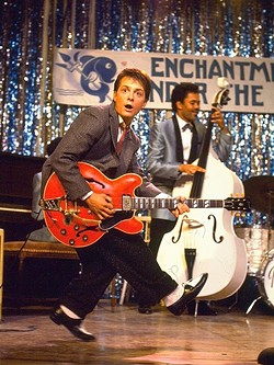 "JOHNNY B. GOODE! :  Marty McFly (Michael J. Fox) ""invents"" rock 'n' roll when he travels back in time and plays a dance at his parents' high school. - PHOTO COURTESY OF UNIVERSAL PICTURES AND AMBLIN ENTERTAINMENT"
