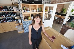 EXOTIC WINES MEET LOCAL LORE:  Want to try a sauvignon blanc from Slovenia or get your hands on a rare local wine off the beaten path? The Station is SLO's new unlikely neighborhood wine bar/hangout nestled in one of the area's first service stations. Pictured, General Manager Jenna Congdon. - PHOTO BY KAORI FUNAHASHI