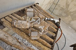 An air hammer is used remove medium and large sized chunks of mold from the bronze. - PHOTO BY STEVE E. MILLER