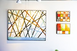 TIC-TAC-TOE:  Paso Robles resident Allen Cox uses oil paint and wax to create intricate images of lines, circles, and abstract forms. - PHOTO BY KAORI FUNAHASHI