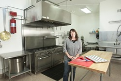 WHAT'S COOKING? :  Laura Kramer built her dream kitchen to can her own green tomato relish, but now the Paso Robles cooking space is available for anyone to rent by calling Kramer at 238-0083. - PHOTO BY STEVE E. MILLER