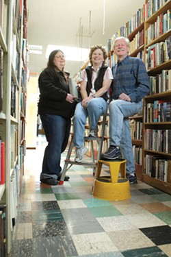 THREE OF A KIND :  Susie Metzler, left, has been manager of Leon's Book Shop for the last 18 years. Catherine and Rick Wiegers have owned the building and store since 1985. A new chapter of their lives will start on May 20, when Leon's closes its doors. - STEVE E. MILLER