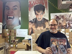 FAIR TRADE:  Arthur Goldiner stands in Scarecrow Vampire Fangs' Grover Beach office with his popular fang teeth, which will be given in return for just a little blood during a blood drive with United Blood Services on Oct. 29. - PHOTO BY REBECCA LUCAS