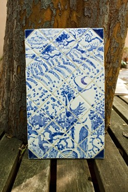 BLUE SKIES :  Traditional Portuguese azulejos are generally comprised of porcelain tiles painted with cobalt blue. Many of Freear's tiles, however, deviate from the expected monochromatic, pastoral scenes. - PHOTO BY STEVE E. MILLER