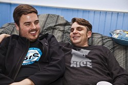 BOND OF WRITERS:  Staff writers Rhys Heyden and Jono Kinkade get comfortable together on the giant beanbag in the living room. - PHOTO BY COLIN RIGLEY